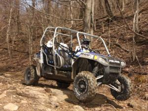 2010.polaris.rzr4_.blue_.front-right.riding.over-rocks.jpg