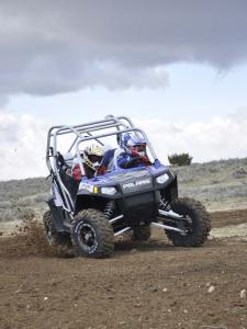2010.polaris.rzr4_.blue_.front_.riding.on-dirt.jpg