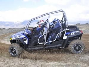 2010.polaris.rzr4_.blue_.left_.riding.on-dirt.jpg