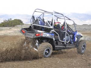 2010.polaris.rzr4_.blue_.rear-right.riding.on-dirt.jpg