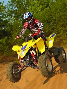 2010.suzuki.ltz400.yellow.front-left.jumping.in-air.jpg