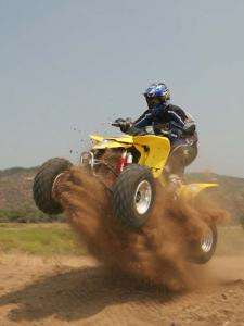 2010.suzuki.ltz400.yellow.front-left.jumping.in-sand.jpg
