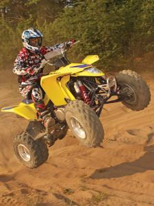 2010.suzuki.ltz400.yellow.front-right.jumping.in-air.jpg