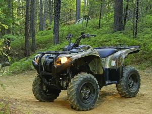 2010.yamaha.grizzly550fi4x4eps.camo_.front-left.parked.on-trail.jpg