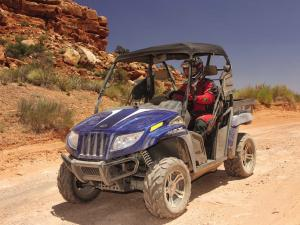 2011.arctic-cat.prowler700xtx.front-left.blue_.riding.on-trail.jpg