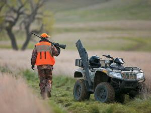 2011.arctic-cat700.camo_.front-right.parked.hunting.jpg