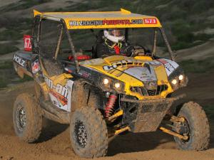 2011.can-am.commander.yellow.front-right.racing.on-dirt.jpg