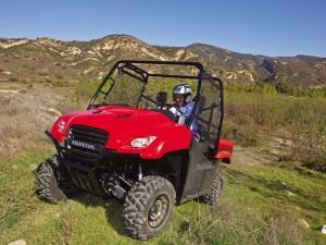 2011.honda_.big-red.red_.front-left.riding.on-grass_0.jpg