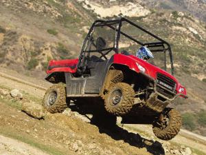 2011.honda_.big-red.red_.front-right.jumping.in-air_0.jpg