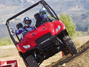 2011.honda_.big-red.red_.front_.riding.on-hill_0.jpg
