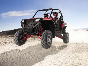 2011.polaris.ranger-rzr900.red_.front-left.jumping.in-air.jpg