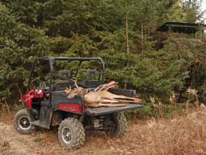 2011.polaris.ranger-xp.red_.rear-left.parked.hunting.hauling-deer.jpg