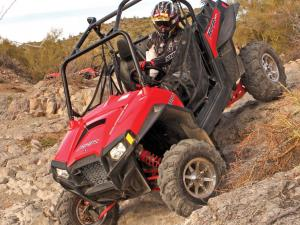 2011.polaris.rzr900xp.front-left.red_.riding.down-hill.jpg