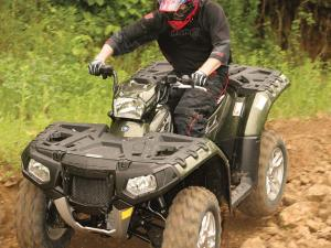 2011.polaris.sportsman550xp.green_.front_.riding.over-rocks.jpg