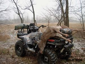 2011.polaris.sportsman800.camo_.rear-left.parked.hunting.hauling-deer.jpg