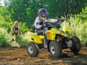 2011.suzuki.quadsport-z90.yellow.front-right.riding.on-trail.jpg