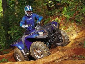 2011.yamaha.grizzly450eps.front-right.blue_.rididng.over-log_0.jpg