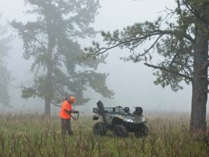 2012.arctic-cat.550.camo.parked.out-hunting.jpg