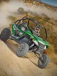 2012.arctic-cat.wildcat.green.front-right.riding.on-dirt.jpg