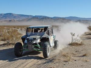 2012.arctic-cat.wildcat1000i.black.front-left.riding.on-sand.jpg
