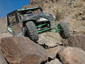 2012.arctic-cat.wildcat1000i.black.front.riding.over-rocks.jpg