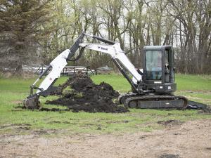 2012.bobcat.e55.escavator.digging.ground.jpg