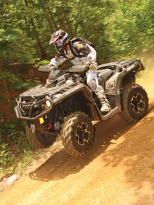 2012.can-am.outlander1000.black_.front-left.riding.wheelie.on-dirt.jpg
