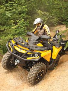 2012.can-am.outlander1000.yellow.front_.riding.up-hill.jpg