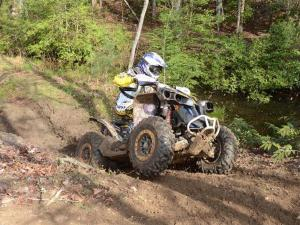 2012.can-am.renegade.front-right.yellow.riding.up-hill.jpg
