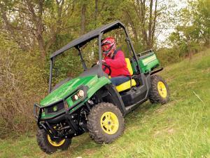 2012.john-deere.gator-xuv550.green_.front-left.riding.on-grass.jpg