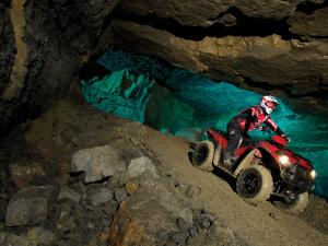2012.kawasaki.brute-force300.red_.front_.riding.in-cave.jpg