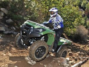 2012.kawasaki.brute-force750-4x4i.green.front-left.riding.over-rocks.jpg