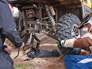 2012.kawasaki.teryx4.close-up.changing-tire.jpg