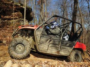 2012.kawasaki.teryx4.red.left.riding.on-trail.jpg