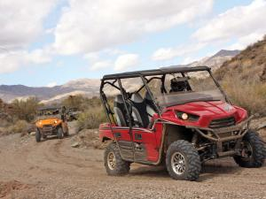 2012.kawasaki.teryx4.right.red.riding.on-trail.jpg