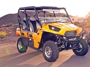 2012.kawasaki.teryx4.yellow.front-right.parked.on-pavement.jpg
