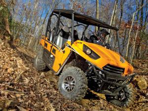 2012.kawasaki.teryx4.yellow.front.riding.on-trail.jpg