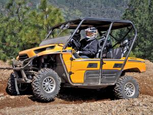 2012.kawasaki.teryx4.yellow.left.riding.on-dirt.jpg