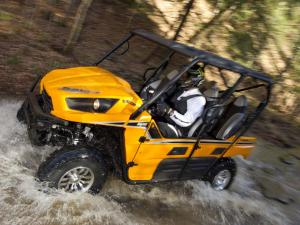 2012.kawsaki.teryx4_.yellow.left_.riding.through-water.jpg
