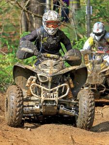 2012.kymco.maxxer450.brendan-golding.front.racing.in-woods.jpg
