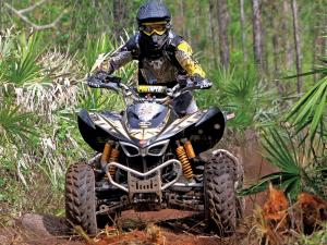 2012.kymco.maxxer450.kyle-golding.front.racing.in-woods.jpg