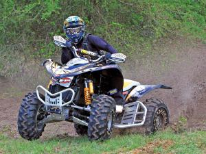 2012.kymco_.maxxer450.zach-stoddard.front_.racing.on-grass.jpg