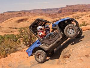 2012.kymco.uxv500i.blue.right.climbing.over-rocks.jpg