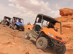 2012.kymco.uxv500i.orange.front-right.riding.over-rocks.jpg
