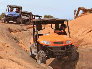 2012.kymco.uxv500i.orange.front.riding.over-rocks.jpg