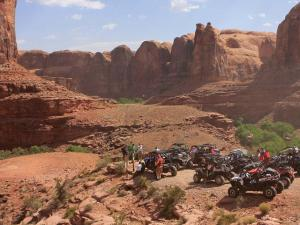 2012.location.moab-utah.arctic-cat-rally-on-the-rocks-event.side-x-sides.parked.in-canyon.jpg