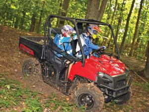 2012.polaris.ranger-xp800.red.front-right.riding.through-woods.jpg