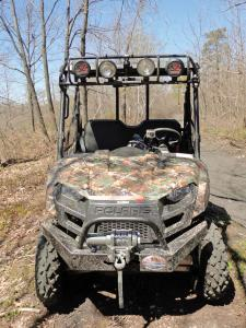 2012.polaris.ranger500.camo.front.parked.on-trail.jpg