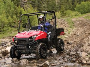 2012.polaris.ranger500efi.red_.front-left.riding.through-water.jpg