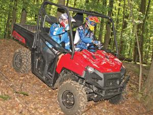 2012.polaris.ranger800xp.red.front-right.riding.through-woods.jpg